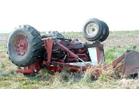 photo of overturned tractor without ROPS